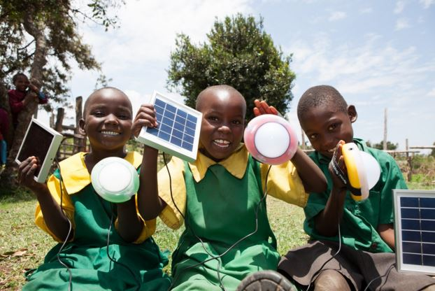 School children show off solar lanterns in Africa