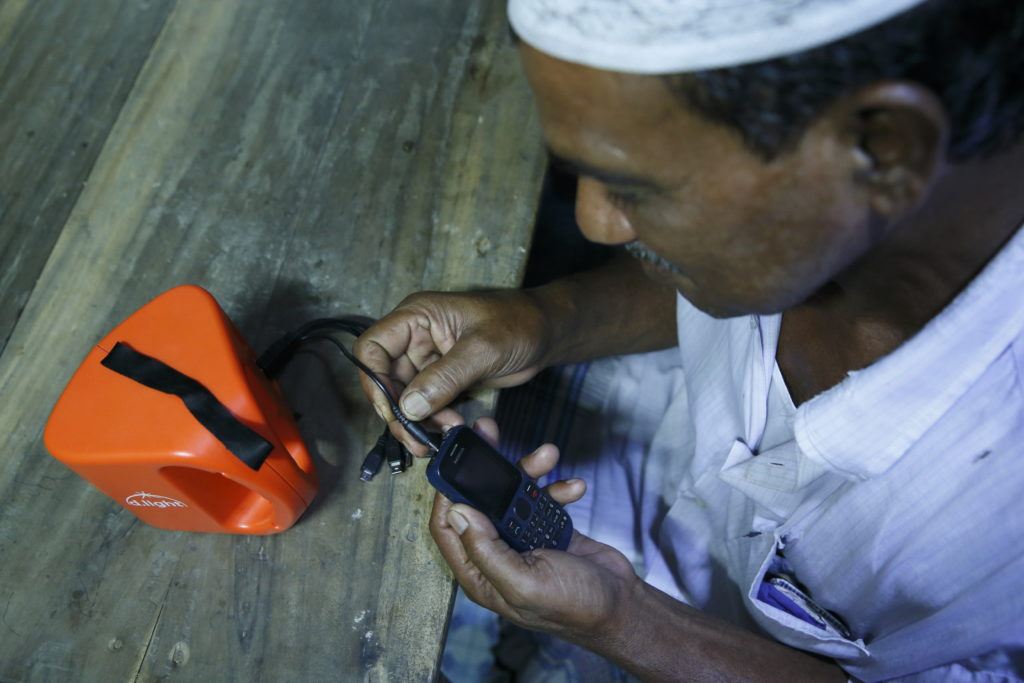 man-in-bangladesh-charging-phone